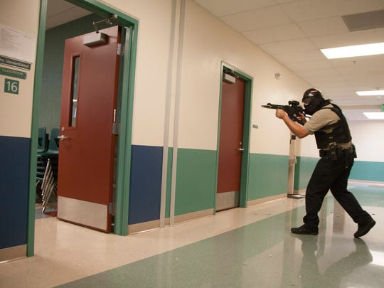 Law enforcement personnel from Washington County work through an annual active shooter training at Little Valley Elementary Wednesday, June 6, 2018.