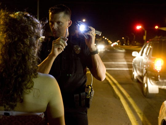 A Phoenix police officer conducts a field sobriety