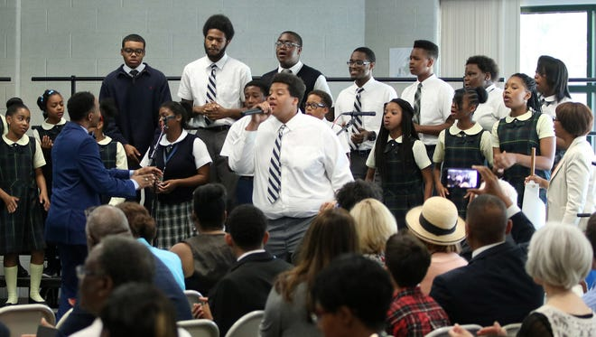"""A group of choir students at Cornerstone Schools entertained the crowd Thursday, June 30, 2016 singing """"Ain't No Stopping Us Now,"""" during an event held in Detroit to announce expansion of the schools that are part of the Cornerstone network."""
