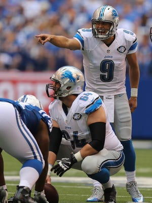 Detroit Lions QB Matthew Stafford calls a play with center Travis Swanson (64) against the Indianapolis Colts during the first half Sunday, September 11, 2016 at Lucas Oil Stadium in Indianapolis, Indiana.