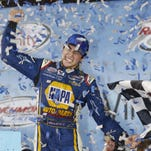 FILE - In this Sept. 26, 2015, file photo, Ryan Blaney adjusts his cap after winning the NASCAR Xfinity series auto race at Kentucky Speedway in Sparta, Ky. With four-time champion Jeff Gordon retired and three-time champ Tony Stewart sidelined with a broken back, the NASCAR season begins with a much different look and a new rules package. (AP Photo/Garry Jones, File)