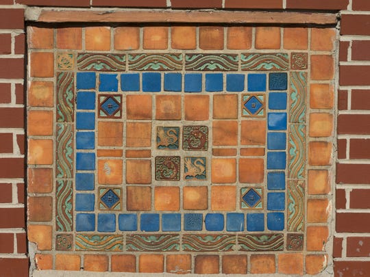 The former movie theater, which closed in 1975, includes ornamental tile in its facade.