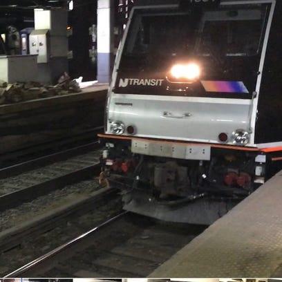 An NJ Transit train pulls into Penn Station in New