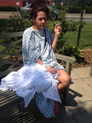 Adrienne Eggers, 29, sits outside of a Somerset hospital,