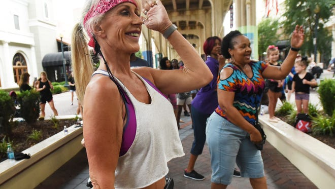 Yvonne McCarthy has fun during the Dancing in the Street event at the Red River District of Shreveport Saturday afternoon.