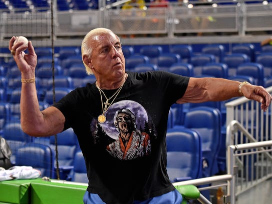 Ric Flair warms up before throwing out the first pitch at Marlins Park prior to a game between the Cincinnati Reds and the Miami Marlins game.