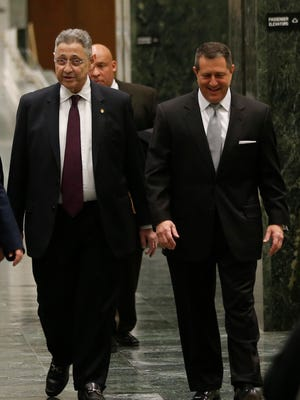 New York Assembly Speaker Sheldon Silver, D-Manhattan, left, and Assembly Majority Leader Joseph Morelle, D-Irondequoit, right, walk though the Legislative Office Building on their way to the Capitol on Monday, Jan. 26, 2015, in Albany, N.Y. Silver was fighting to keep his grip on power Monday amid widening calls for his resignation in the wake of federal corruption charges.