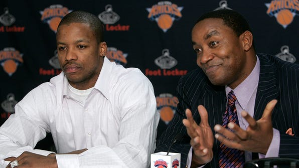 New York Knicks guard Steve Francis, left, looks on as President of Basketball Operations Isiah Thomas responds to a question during a news conference Wednesday Feb. 22, 2006 at Madison Square Garden in New York. The Knicks announced today that Francis has been acquired from the Orlando Magic in exchange for Anfernee Hardaway and Trevor Ariza. (AP Photo/Frank Franklin II) ORG XMIT: NYFF107