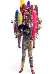 "Nick Cave, ""Soundsuit,"" 2015, mixed media, including synthetic hair, ceramic birds, strung beads, wire, metal, and mannequin, 108x43x40. Private collection, Nashville. ©Nick Cave."