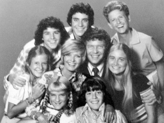 "Greg Brady, middle back, is shown with his ""The Brady Bunch"" family."