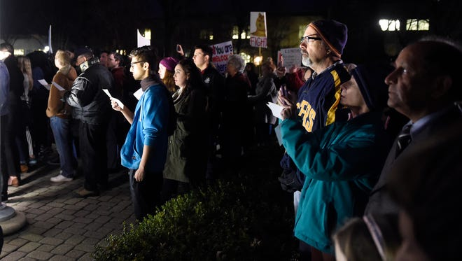 Evansville religious leaders take turns speaking at UE's Clifford Circle as declare their support for refugees and others affected by the president's executive order barring refugees and residents of seven countries from entering the United States during an interfaith rally of support Tuesday.