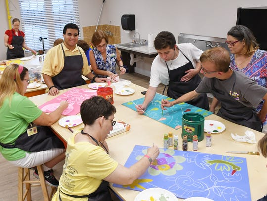 Residents and instructors are pictured in the Creative Arts Center at Promise in Brevard, which along with housing for adults with special needs offers vocational training, employment and health and fitness instruction.