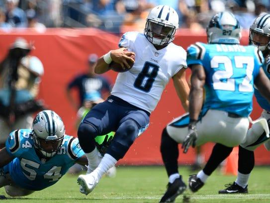 Tennessee Titans quarterback Marcus Mariota (8) slides