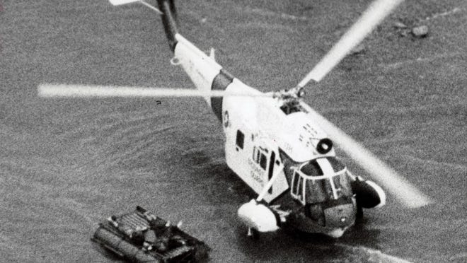 A Coast Guard helicopter hovers over a raft from the sunken freighter Daniel J. Morrell after rescuing Dennis Hale, the sole survivor of the 1965 sinking off Port Hope.