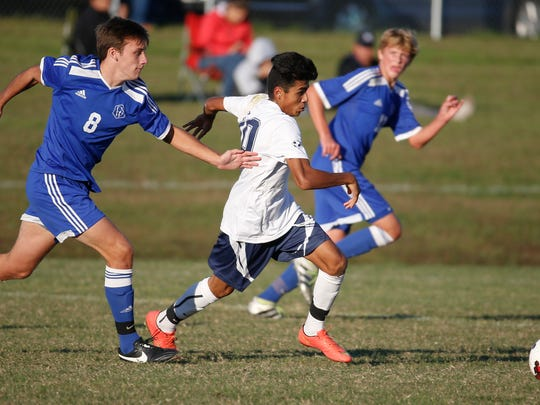 Charter's Andy Brown pursues Delcastle's Saul Robles-Lomeli in the second half of Charter's 6-0 win.