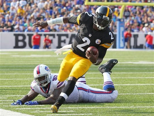 Pittsburgh Steelers quarterback Michael Vick (2) runs past Buffalo Bills defensive tackle Corbin Bryant (97) during the first half of a preseason NFL football game on Saturday, Aug. 29, 2015, in Orchard Park, N.Y.