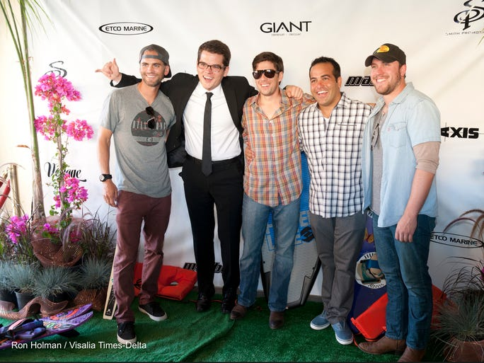 Professional wake skater Brian Grubb, left, Alex Oliver, Brad Clawson, Chad Borba and Mitchell Tenpenny pose for pictures on Thursday, June 26, 2014 at the Visalia Fox Theatre before the screening of Voyage, a film staring local people, including Borba, from Visalia who trek down the Mississippi.