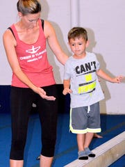 Cheer & Tumble owner TaNessa Sedillo helps Koen Duarte, 4, keep his balance on Wednesday.