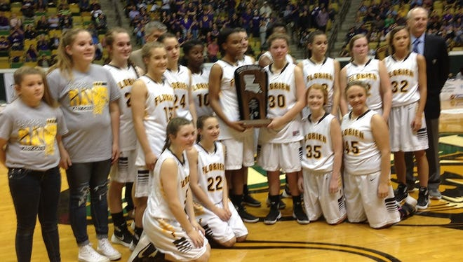 The Florien Lady Cats accept the LHSAA  Class B state runner-up trophy.