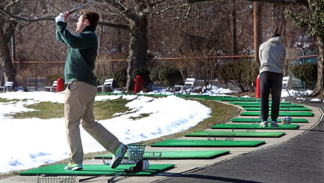 Golfers take advantage of the warm weather and practice their swing at Westchester Golf Range in Greenburgh Feb.17, 2017