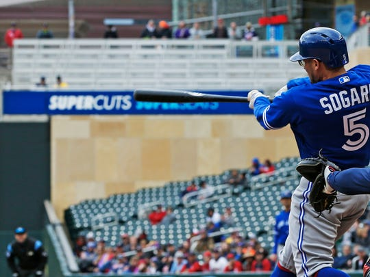 Toronto Blue Jays' Eric Sogard hits a three-run, bases loaded double off Minnesota Twins pitcher Michael Pineda in the fourth inning of a baseball game Thursday, April 18, 2019, in Minneapolis. (AP Photo/Jim Mone)