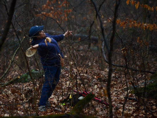 Frieda Eberly of East Pennsboro Township throws a disc during a round of disc golf, safari style, at Gifford Pinchot State Park Tuesday, January 17, 2017.