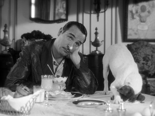 """Jean Dujardin appears in a scene from the black and white, silent 2012 film """"The Artist,"""" which won an Oscar for Best Picture."""