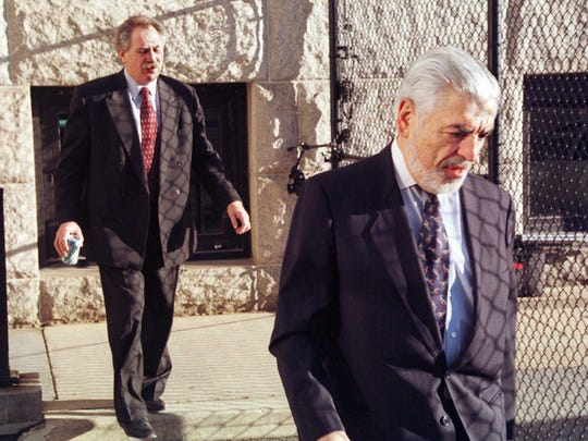 Joseph S. Oteri, right, and John F. O'Donell, defense attorneys for Thomas Capano, leave the rear entrance to the courthouse in Wilmington, Del., Sunday, Jan. 17, 1999, after meeting with their client Thomas Capano before he was convicted on a first-degree murder charge in the death of Anne Marie Fahey.