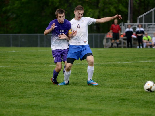 Trinity Christian Academy's Alex Northcut and Jackson Christian's John Pate battle for possession of the ball during their game, Tuesday.