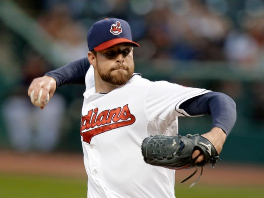 Cleveland Indians starting pitcher Corey Kluber delivers in the first inning of a baseball game against the Tampa Bay Rays, Friday, Sept. 26, 2014, in Cleveland. (AP Photo/Tony Dejak)