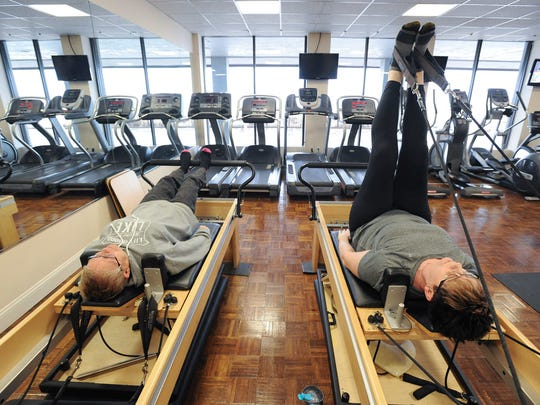 Pat Higgins, left and her partner Janet Idema of Rehoboth Beach working out at Elite Physical Therapy in Rehoboth Beach.