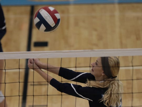 Boone County's Rhiannon Strickler  gets the ball over the net.