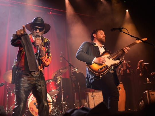 Robert Finley, left, and Dan Auerbach perform at Ryman Auditorium in Nashville.