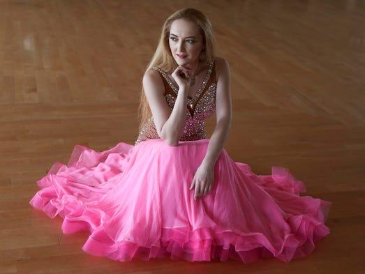 Anna Akarman wears a pink chiffon ballroom dance dress