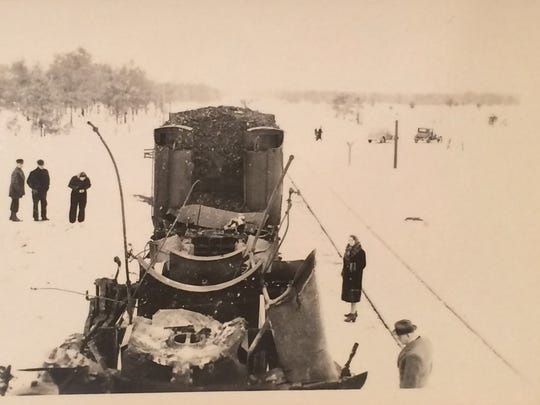 Several people inspect the damage following the 1940 train explosion that killed three men near Wausau.