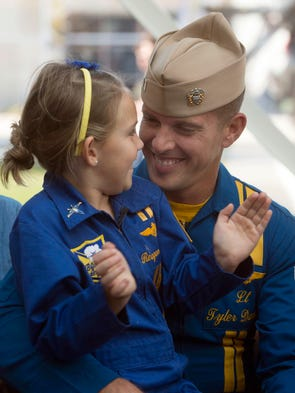 Reagan Davies, left, celebrates the return of her father,