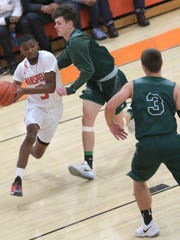 Mansfield Senior's B.J. Patrick draws a Madison double team as he drives to the basket.