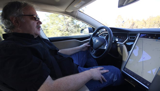 A Tesla driver takes a Tesla car out for a test drive.