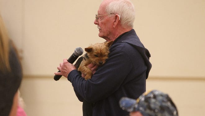 U.S. Marine Corps veteran Richard Raker asks a question about his service dog, Rocky, at a VA town hall Wednesday night in Redding.