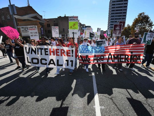 People march as they participate in the '#NoMuslimBanEver'