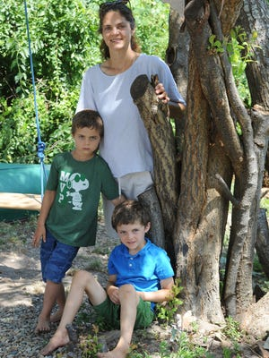 """Tyra Nichols-Canning, of Brewster, is opting for a home-schooling hybrid model offered by the new Cape Cod Christian Academy for her sons Sam, 7, right, and Luke, 5. """"I would rather not send my kids to school with all the uncertainty -- the directional tape and plexiglass,"""" she said."""