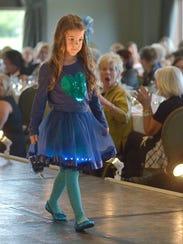 Madeline Winder showed off a children's outfit.
