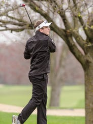Novi's Trevor Angell launches a tee shot in the Kensington