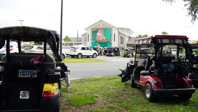 Worship at Live Oaks Community Church, which is located in The Villages retirement community in Oxford, Florida, has gone on uninterrupted during the pandemic because the church meets outside and most people use golf carts to attend services.