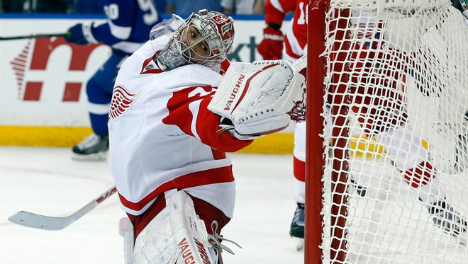 Petr Mrazek #34 of the Detroit Red Wings watches a goal by Andrej Sustr #62 of the Tampa Bay Lightning in Game Two of the Eastern Conference Quarterfinals during the 2015 NHL Stanley Cup Playoffs at Amalie Arena on April 18, 2015 in Tampa, Florida.