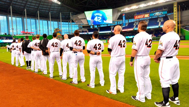 Marlins players wearing No. 42 in honor on Jackie Robinson.