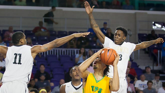 Hudson Catholic's Luther Muhammad, left, and Tyheem Burno block the shot of The Patrick School's Nick Richards during play Sunday at the Culligan City of Palms Classic at the Suncoast Credit Union Arena in Fort Myers.