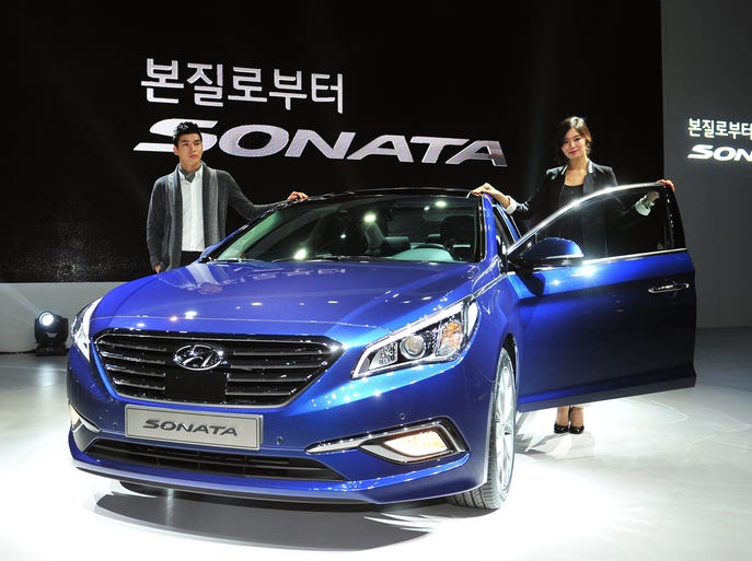 South Korean models pose with Hyundai Motor's new sedan, the Sonata