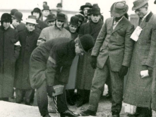 Gov. Thomas R. Marshall places a brick during the rededication ceremony of the Indianapolis Motor Speedway in 1909.