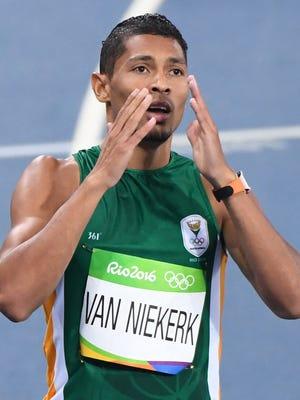 Wayde Van Niekerk reacts after winning the men's 400-meter final.
